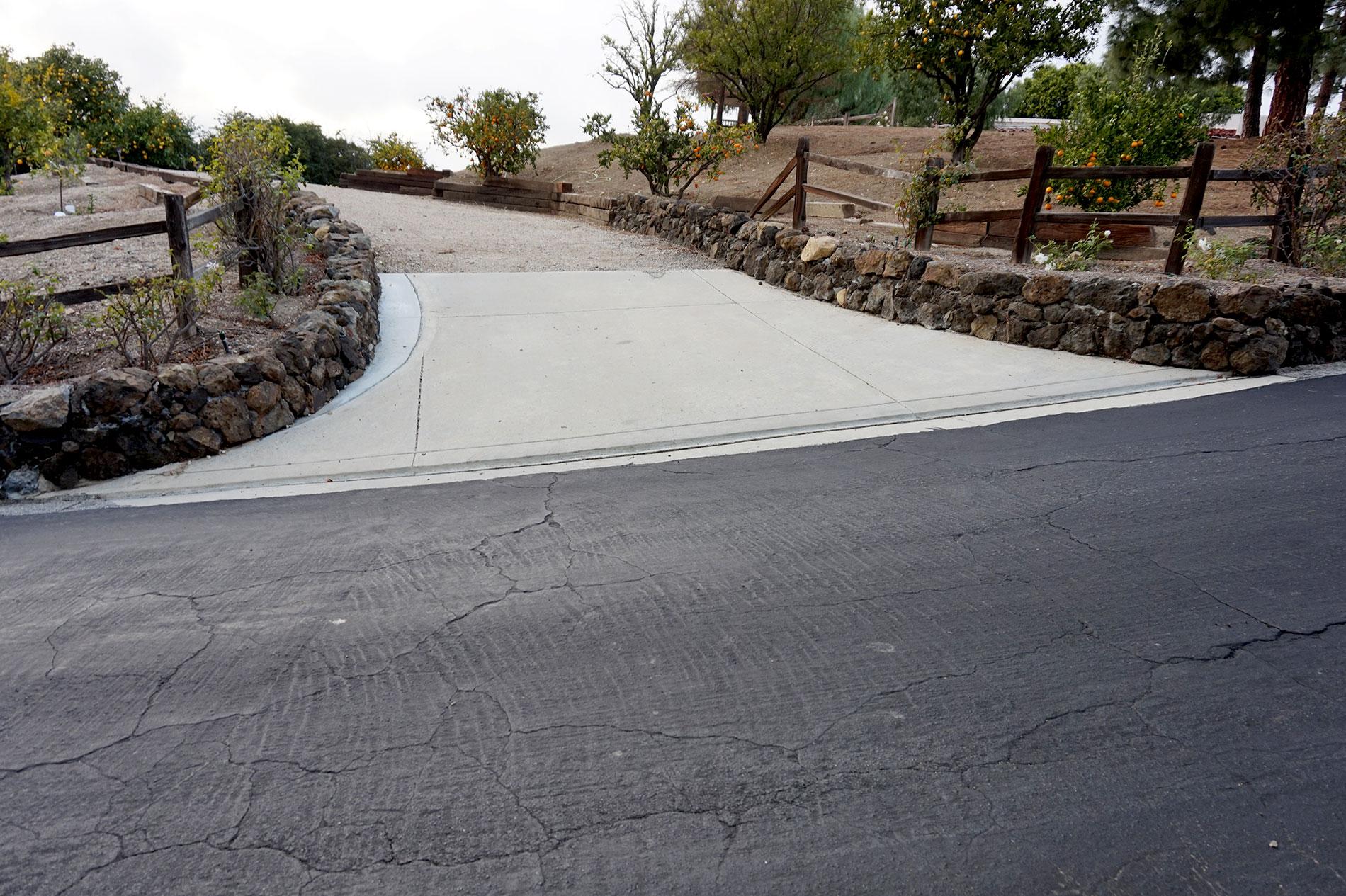 Custom Stone Wall Lined Driveway