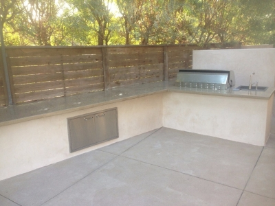 Backyard BBQ setup with custom concrete countertops