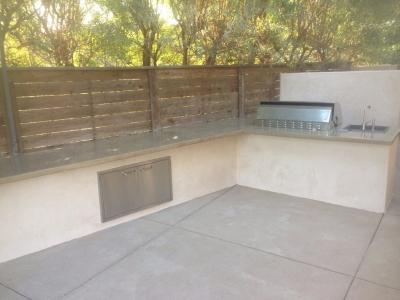 Backyard BBQ setup with custom concrete countertops