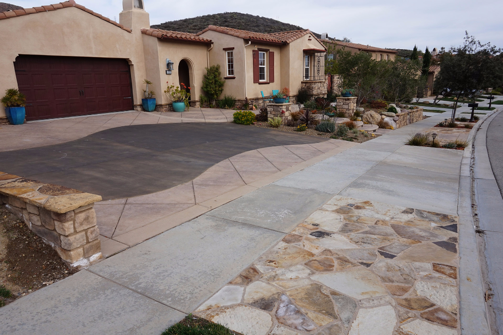 Custom Concrete Driveway with Stone Sidewalk Features in Newbury Park