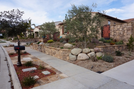 Retaining wall with Creative Stone Features in Dos Vientos Newbury Park