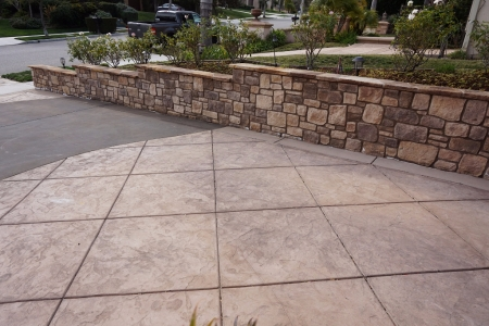 Stamped Concrete Driveway and Custom Stone Retaining Wall