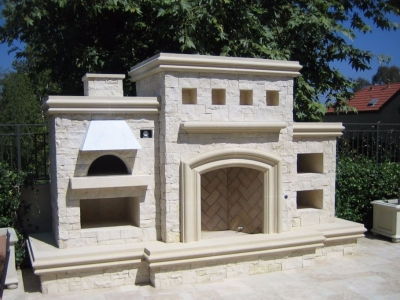 Stone and concrete pizza oven fireplace combo