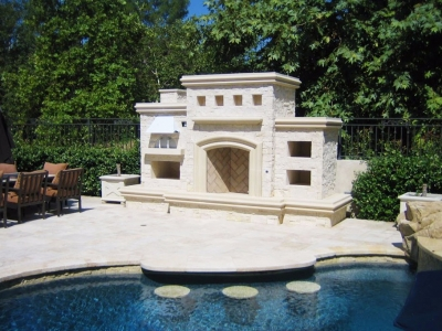 Poolside fireplace with pizza oven