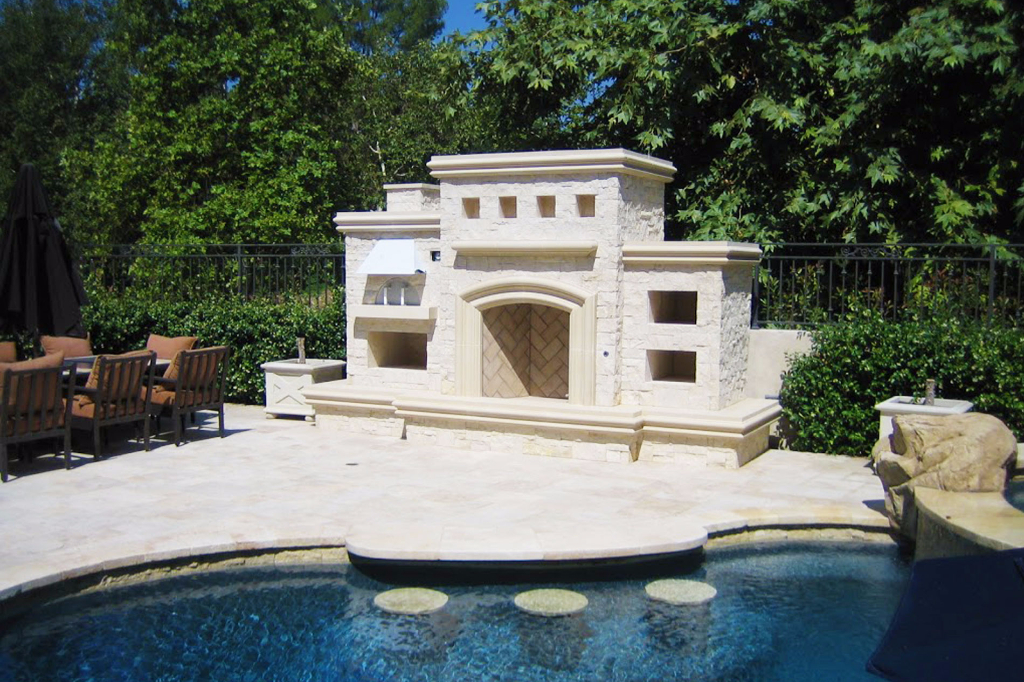Poolside Concrete Fireplace with Pizza Oven