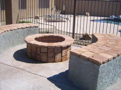 Backyard fire pit made of stone and concrete