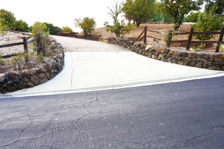 Concrete Driveway with Stone Retaining Walls