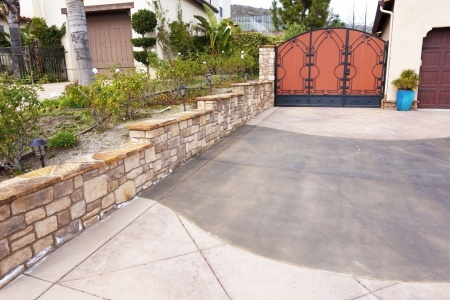 Stamped Concrete Driveway with Stone Retaining Wall