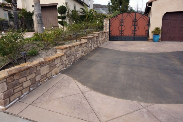 Stone Property Line Wall and Stamped Concrete Driveway Alt View