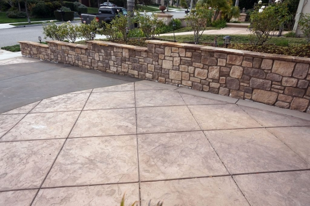 Stone Property Line Wall and Stamped Concrete Driveway alt view 2